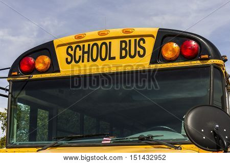 Kokomo - Circa October 2016: Yellow School Buses in a District Lot Waiting to Depart for Students III