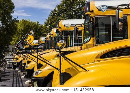 Kokomo - Circa October 2016: Yellow School Buses in a District Lot Waiting to Depart for Students II
