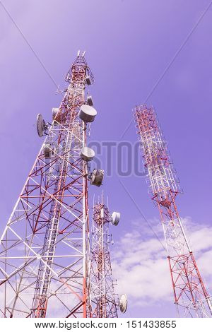 Telecommunication tower and TV broadcast tower against blue sky background