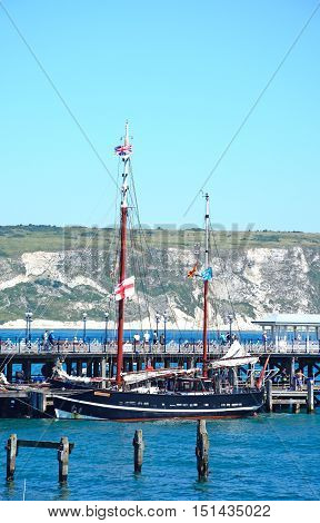 SWANAGE, UNITED KINGDOM - JULY 19, 2016 - The Moonfleet tallship moored alongside the Victorian pier Swanage Dorset England UK Western Europe, July 19, 2016.