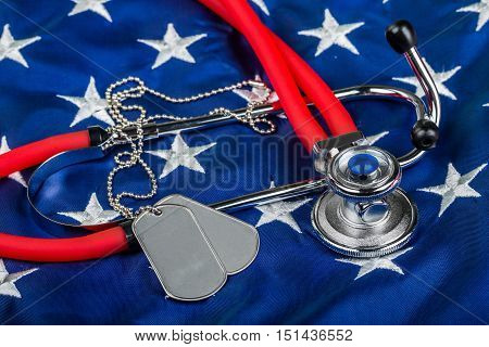 Blank Dog Tags and Stethoscope on American Flag