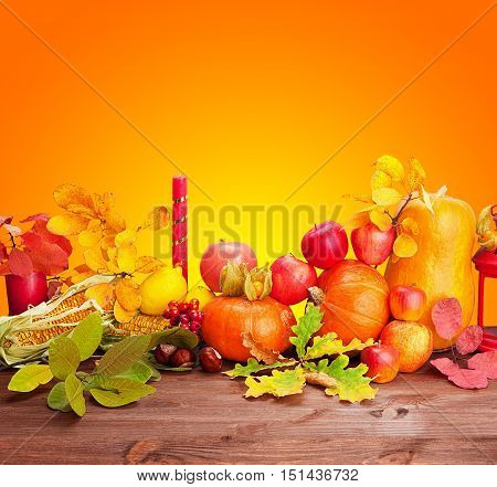 Composition of fruits and vegetables Thanksgiving on a table and orange background with copy space