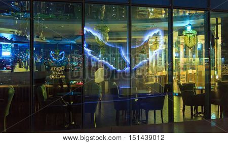 Busan South Korea - September 12th 2016: Busan a night kind and reflexion on glass of a show-window of cafe Angel in-us Coffee.