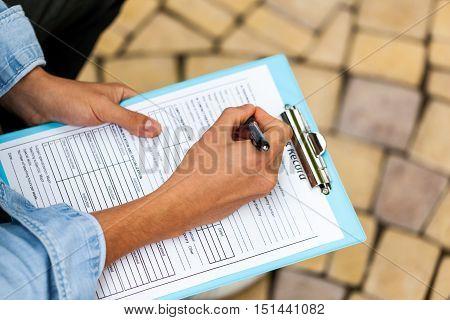 Closeup of a Person Filling a Track Record