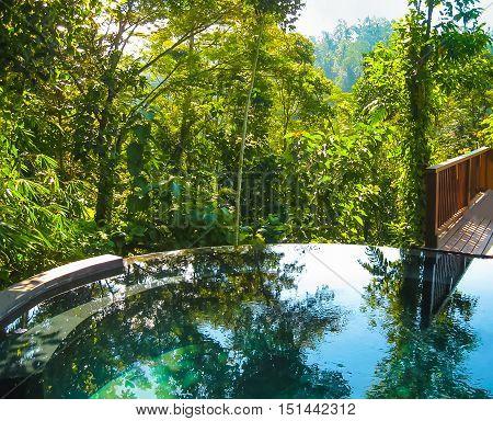 Bali Indonesia - April 14 2014: View of swimming pool at Nandini Bali Jungle Resort and Spa.
