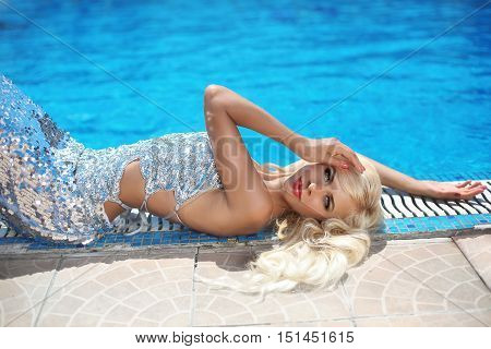 Fashion Outdoor Portrait Of Beautiful Sensual Woman With Long Blond Hair In Elegant Dress Relaxing B