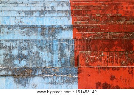 Blue and red bleachers steps in horizontal 3:2 format.