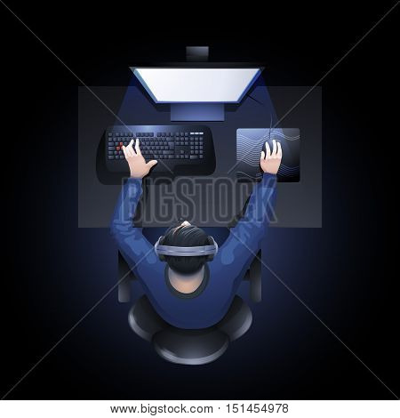 Young man sitting at the table and playing computer. Top view. Cyber sport concept.