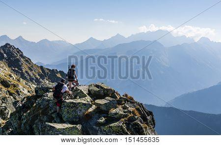 Girl And Boy On The Ridge.