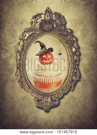 Gilt frame with Halloween cupcake and spider