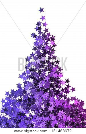 Blue and purple star shaped glitter on white as a background