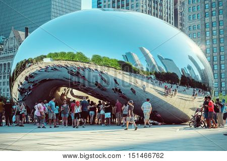CHICAGO - JULY 2016: Cloud Gate sculpture in Millenium park in Chicago IL. This public sculpture is the centerpiece of the AT&T Plaza in Millennium Park within the Loop community area.