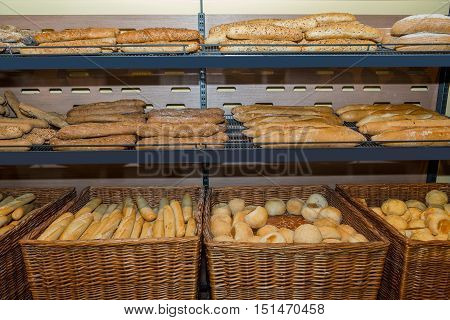 Several types of whole-grain cereal kinds of pastries on the counter in the store