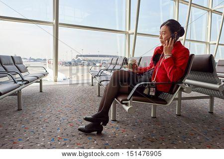 HONG KONG - NOVEMBER 03, 2015: indoor portrait of a woman at Hong Kong Airport. Hong Kong International Airport is the main airport in Hong Kong. It is located on the island of Chek Lap Kok.
