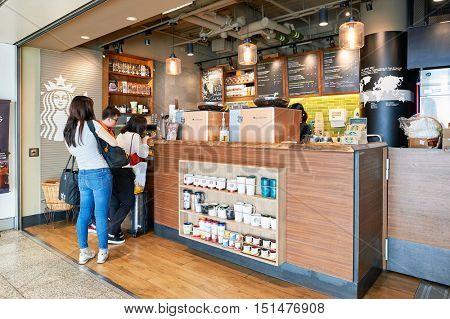 HONG KONG - NOVEMBER 03, 2015: Starbucks cafe at Hong Kong Airport. Hong Kong International Airport is the main airport in Hong Kong. It is located on the island of Chek Lap Kok.