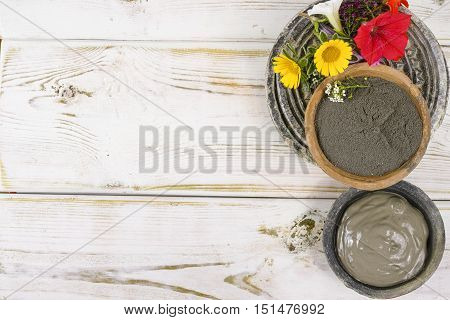 Ancient minerals - black clay powder and mud mask for spa beauty concept