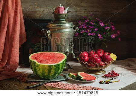 Rural still life with red color subjects and samovar