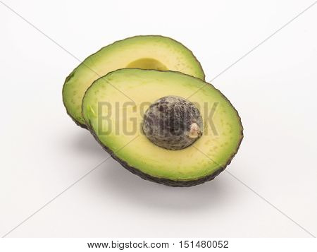 Avocado Split with Pit in tact isolated on white background