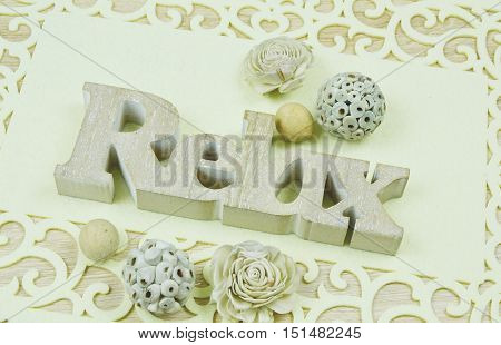 Relax carved wooden letters  and potpourri (vintage) soft focus,lens blur