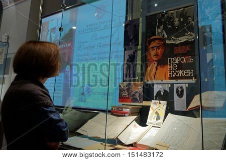 ST. PETERSBURG, RUSSIA - OCTOBER 7, 2016: People in the exhibition dedicated to 85th anniversary of Russian bestselling author Julian Semyonov in the Presidential library