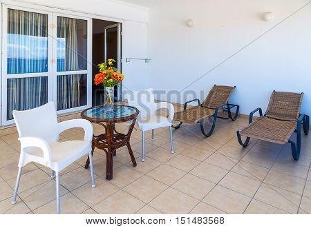Interior of new apartment, veranda with sunbeds