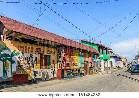Livingston Guatemala - August 31 2016: Building walls painted with local Garifuna musicians in street in Caribbean town of Livingston