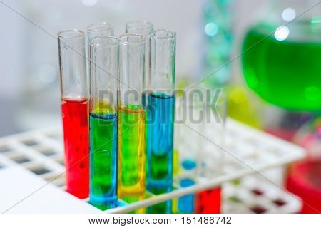 Close up of laboratory glass tubes with colorful reactives