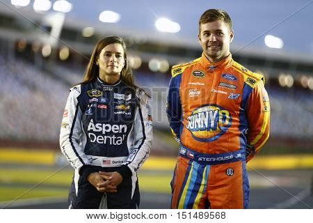 Concord, NC - Oct 06, 2016: Ricky Stenhouse Jr. (17) and Danica Patrick (10) hang out on pit road before qualifying for the Bank of America 500 at the Charlotte Motor Speedway in Concord, NC.
