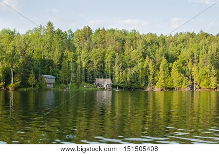 Lonely wooden cottages on a northern Ontario lake, Canada.