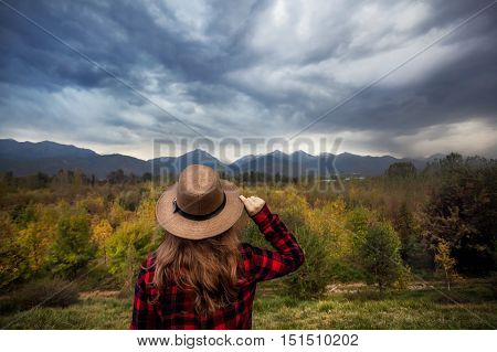Woman In Hat At Autumn Mountains Landscape