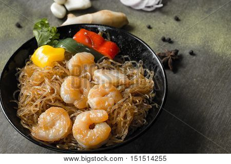 Casserole prawns with glass noodles / Shrimp potted with vermicelli. Close up.