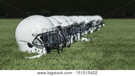 Row of American football Helmets before a game. Football abstract photo with copy space