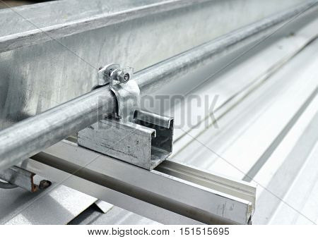 Electrical Conduit Installation on Metal Sheet Roof