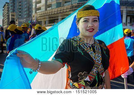 Kota Kinabalu,Sabah-Aug 31,2016:A beautiful Kadazandusun woman in traditional attire with background of Sabah flag during the Malaysia National Day at Kota Kinabalu,Sabah,Borneo on 31st Aug 2016.