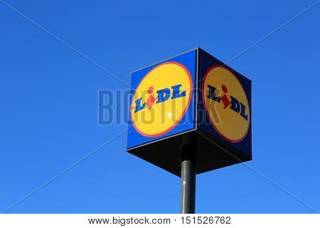HALIKKO FINLAND - OCTOBER 8 2016: Sign Lidl against blue sky in Halikko Finland. The German global discount supermarket chain Lidl Stiftung & Co. KG has currently 152 stores in Finland.