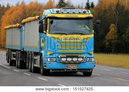 KAARINA, FINLAND - OCTOBER 9, 2016: Customized colorful Scania V8 combination vehicle trucking on autumn road.