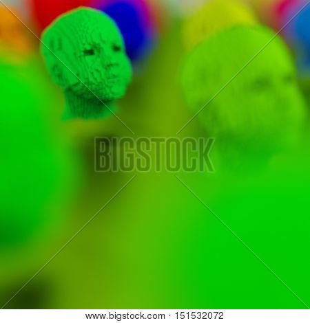 Close-up of green human head 3d model blurred foreground