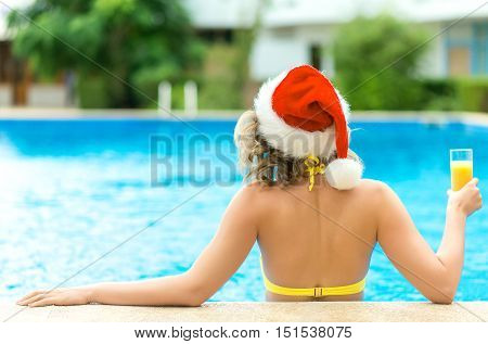 Pretty Woman Enjoying Her Christmas Vacations Near The Pool.