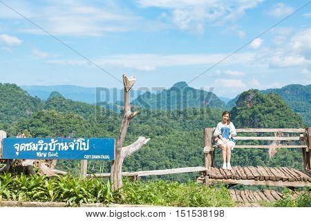 Asian woman at viewpoint