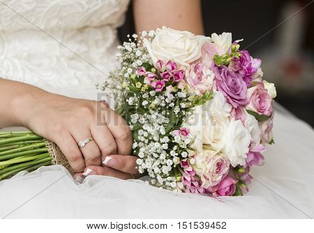 Nice wedding bouquet in bride's hand ( wedding day )