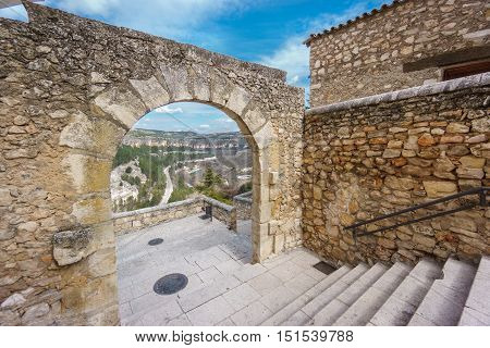 Ultra wide angle view of vintage stone arch in Cuenca