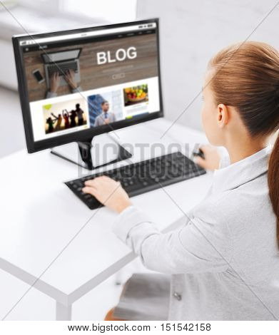 business, people, technology, blogging and education concept - businesswoman or student girl with internet blog page on computer screen sitting at office table