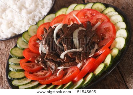 Cambodian Beef Lok Lak With Fresh Vegetables And A Side Dish Of Rice. Horizontal