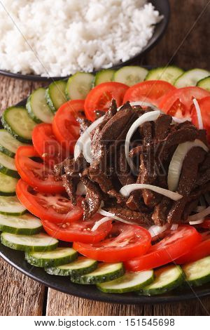 Cambodian Food: Beef Lok Lak With Fresh Tomatoes And Cucumbers Close-up. Vertical