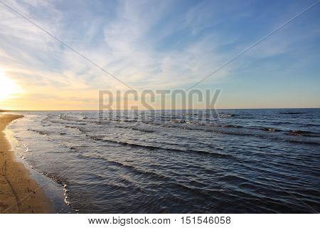 Sea water with small waves in Jurmala Latvia. Coast of Baltic sea.