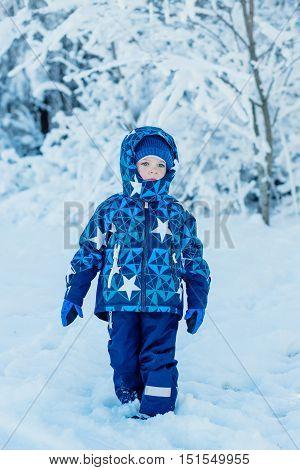 winter portrait Toddler boy in the snow