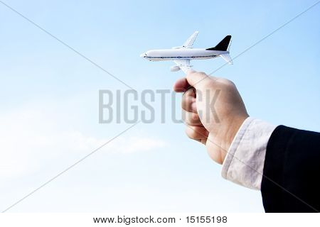 Businessman Playing With A Toy Plane
