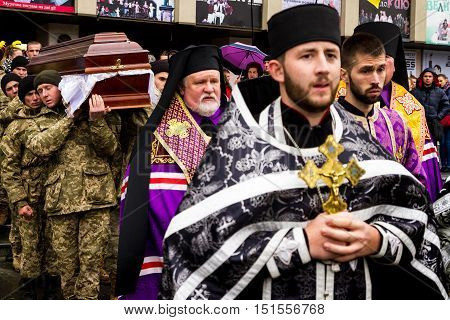 Uzhhorod Ukraine - 2016. October 12: The military honor guards carry the coffin of their comrade who died of his wounds in the ATO zone. The coffin with the body of the deceased Ukrainian heroic warrior honorably carried the city center and was buried on