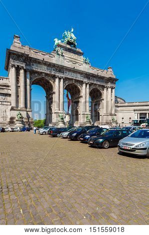 Brussels, Belgium - April 5, 2008: Tourists Walk In Front Of Cinquantenaire Arch (1880-1905)