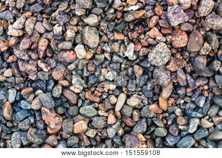 Abstract background with decorative floor pattern of wet sea gravel stones, Gravel texture